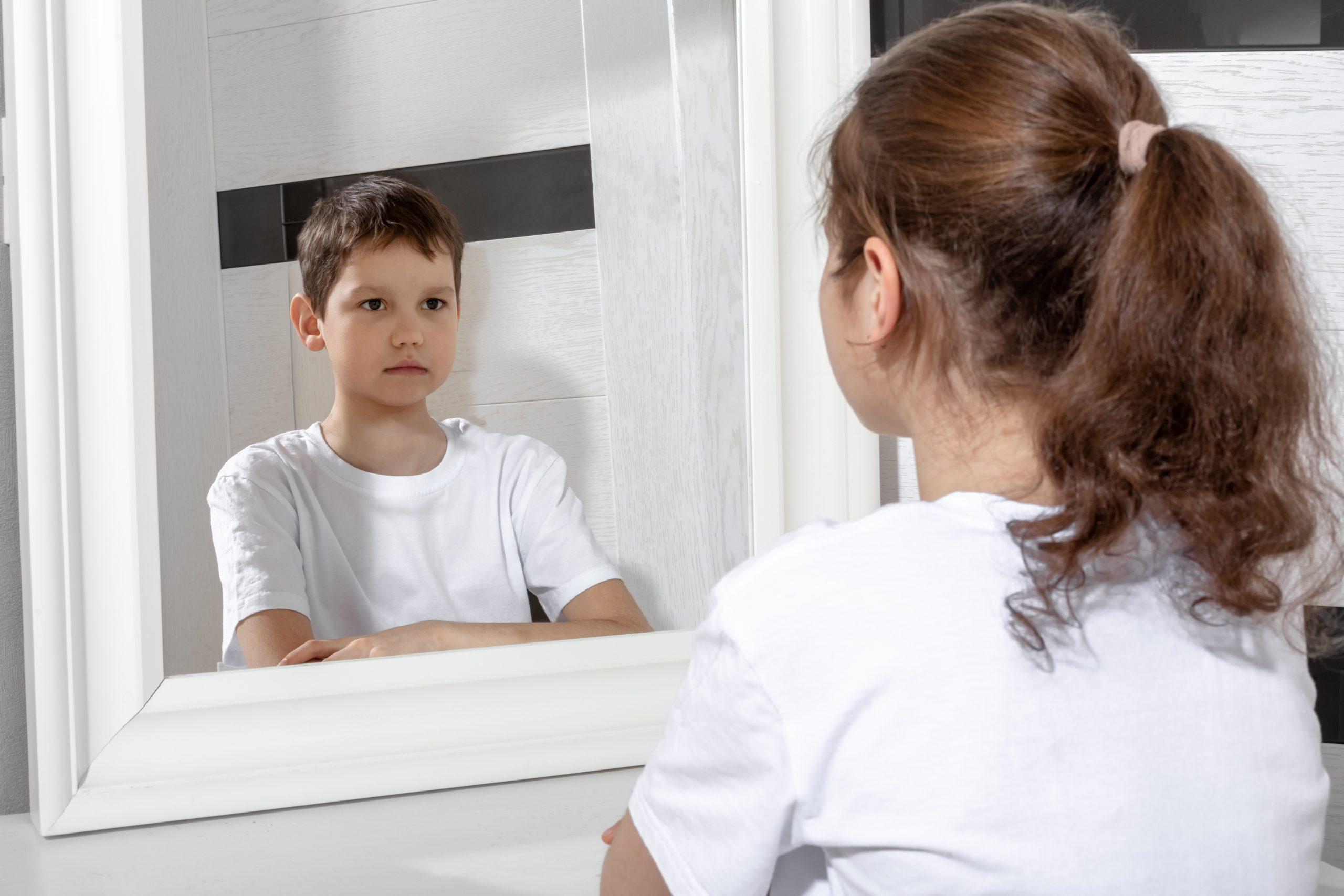 Transgender Boy Looking in Mirror - a Boy Like Me